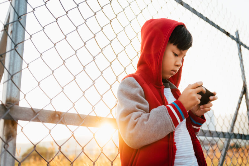 A child uses a smartphone.